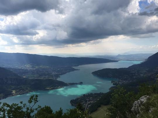 View over Annecy Lake in France with a lake running through a valley