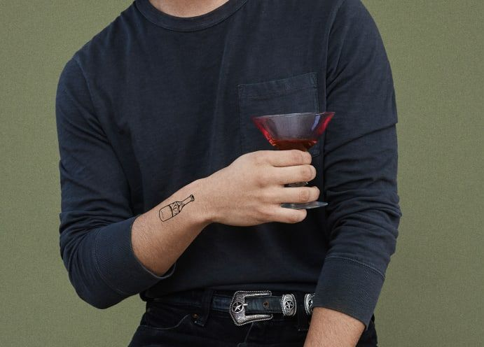 ephemeral temporary tattoo simple line design for men alcohol bottle on wrist
