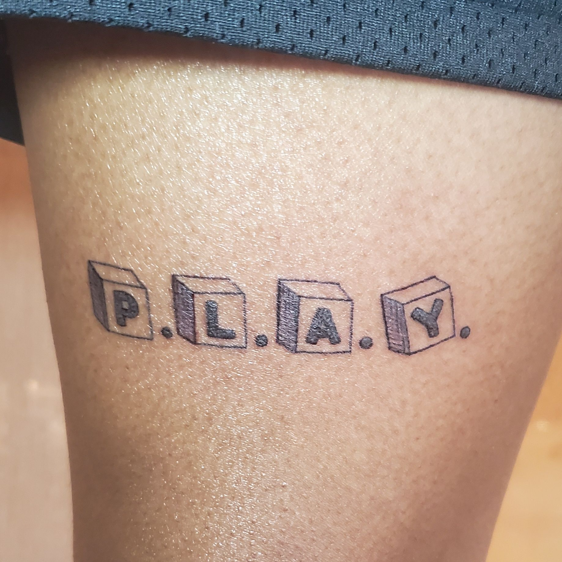 custom word font tattoo design for men with black ink