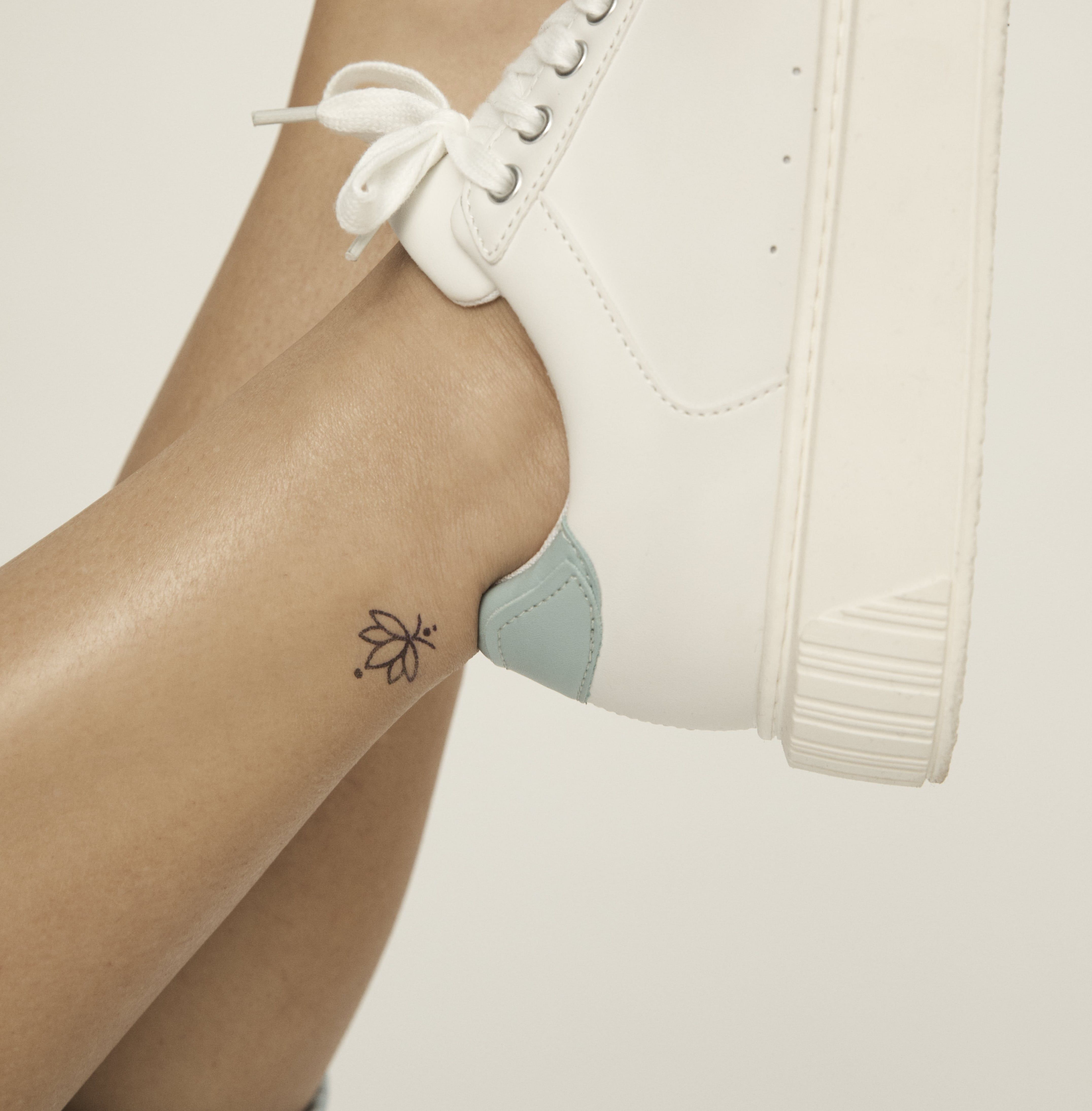 simple ankle temporary tattoo idea for women