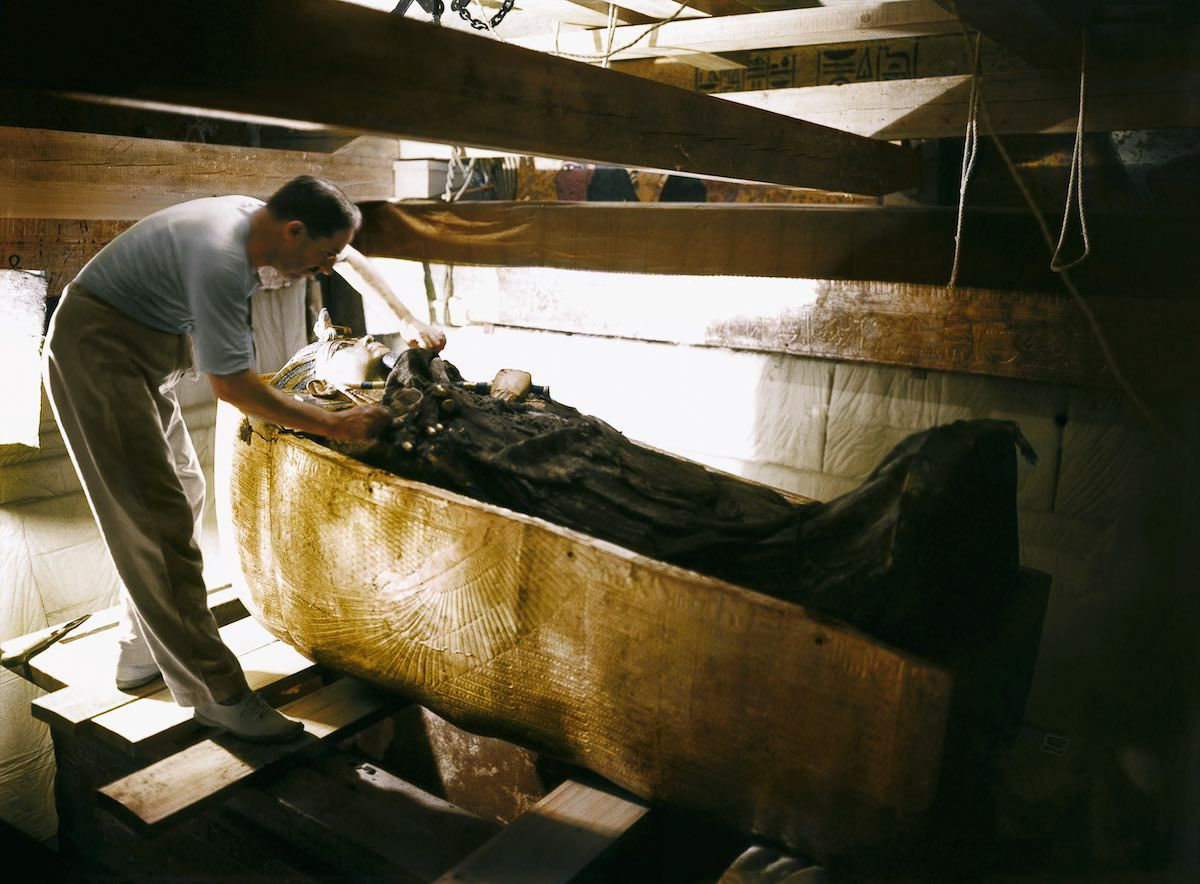 Tutankhamun's Tomb, October 1925, Howard Carter working on the lid of the second coffin, colorized by Dynamichrome.