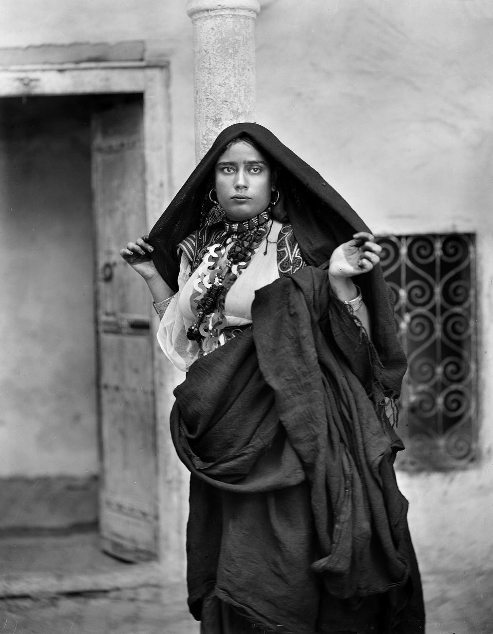 Photograph of woman wearing skhab necklace, c. 1890