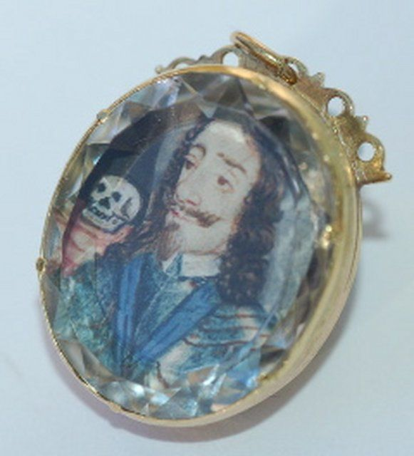 Stuart crystal pendant c. 1650-1660, set with a watercolor portrait on vellum. The skull signifies Charles's death.