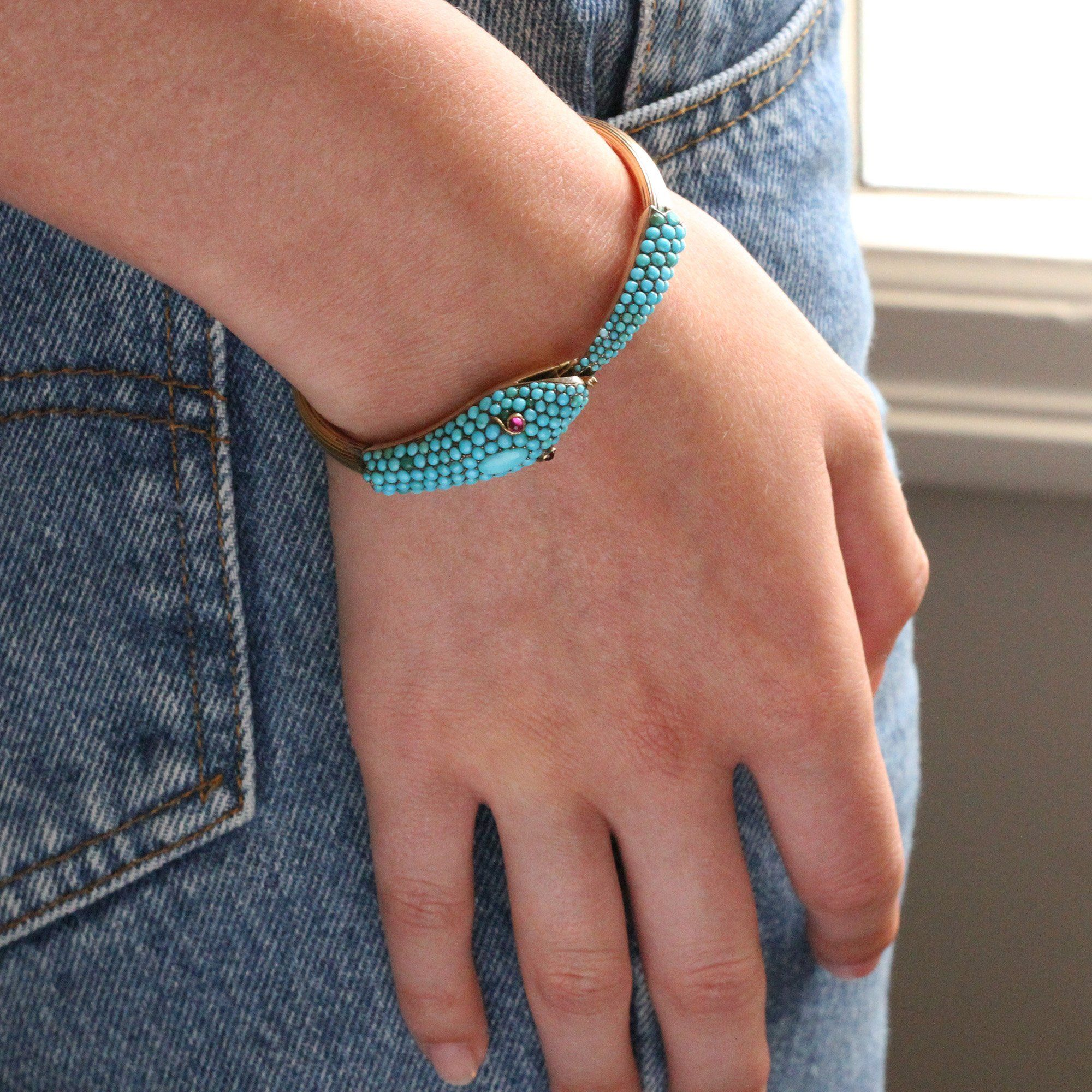 Closeup of someone wearing the Victorian Turquoise Pavé Serpent Bangle