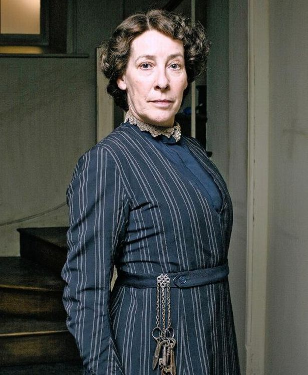 Downtown Abbey's Mrs. Hughes wearing a chatelaine.