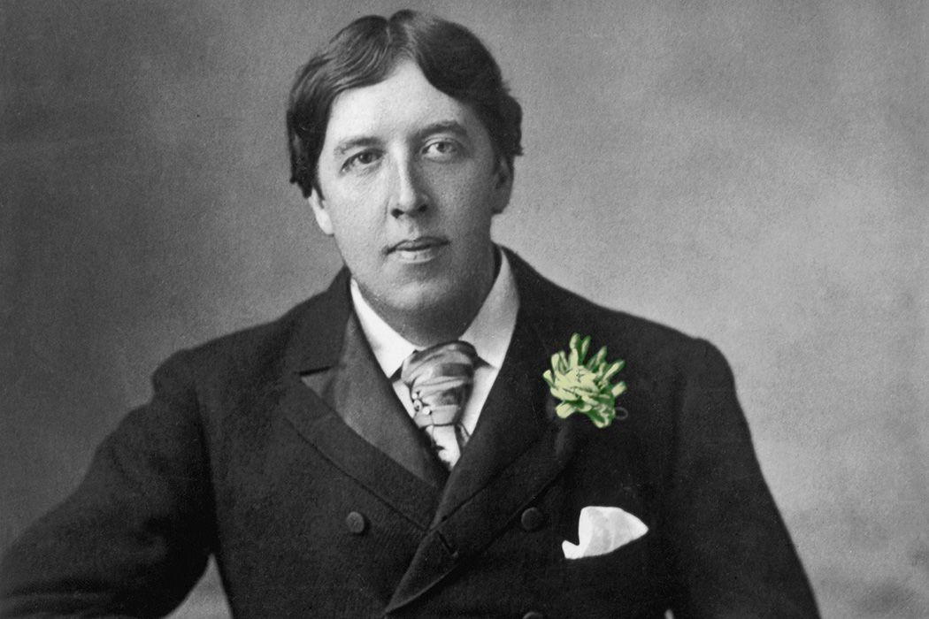 Oscar Wilde wearing a green carnation.