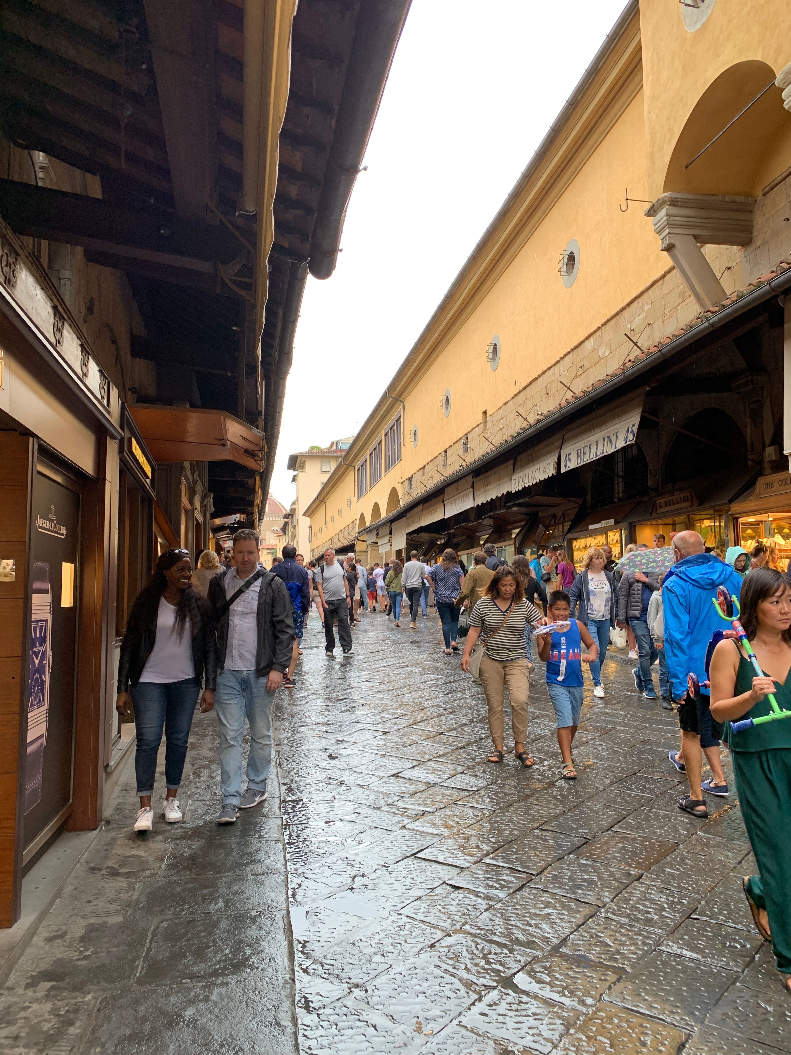 Tourists (like me!) shopping for souvenirs on the Ponte Vecchio, Florence, 2019.