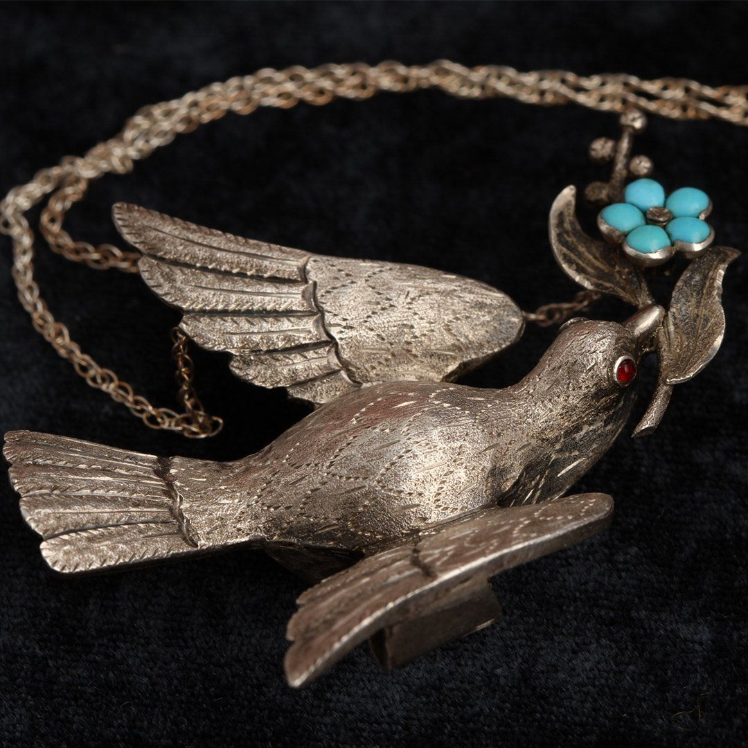 Detail of Mid Victorian Silver Dove Necklace with Garnet Eyes and Turquoise Forget Me Not