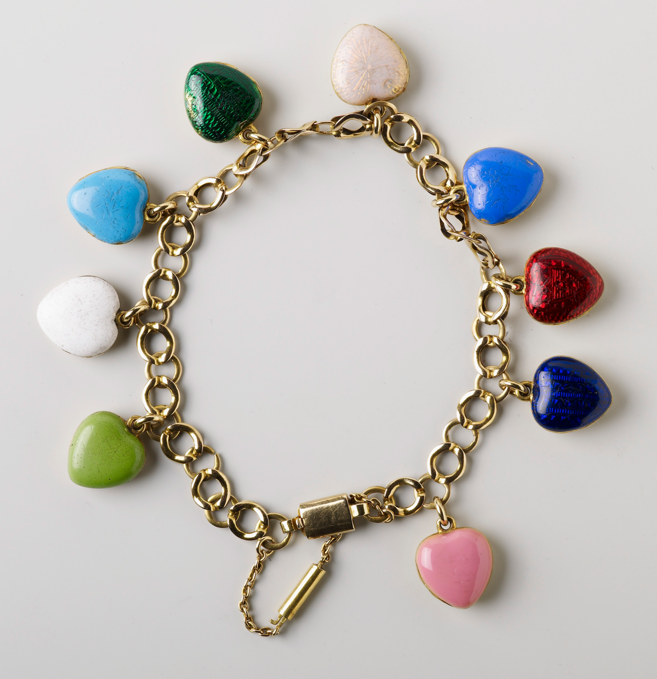 Queen Victoria's bracelet with lockets for each child: pink for Princess Victoria, turquoise blue for Albert, red for Princess Alice, dark blue for Alfred, translucent white for Helena, dark green for Louise, mid blue for Arthur, opaque white for Leopold and light green for Beatrice