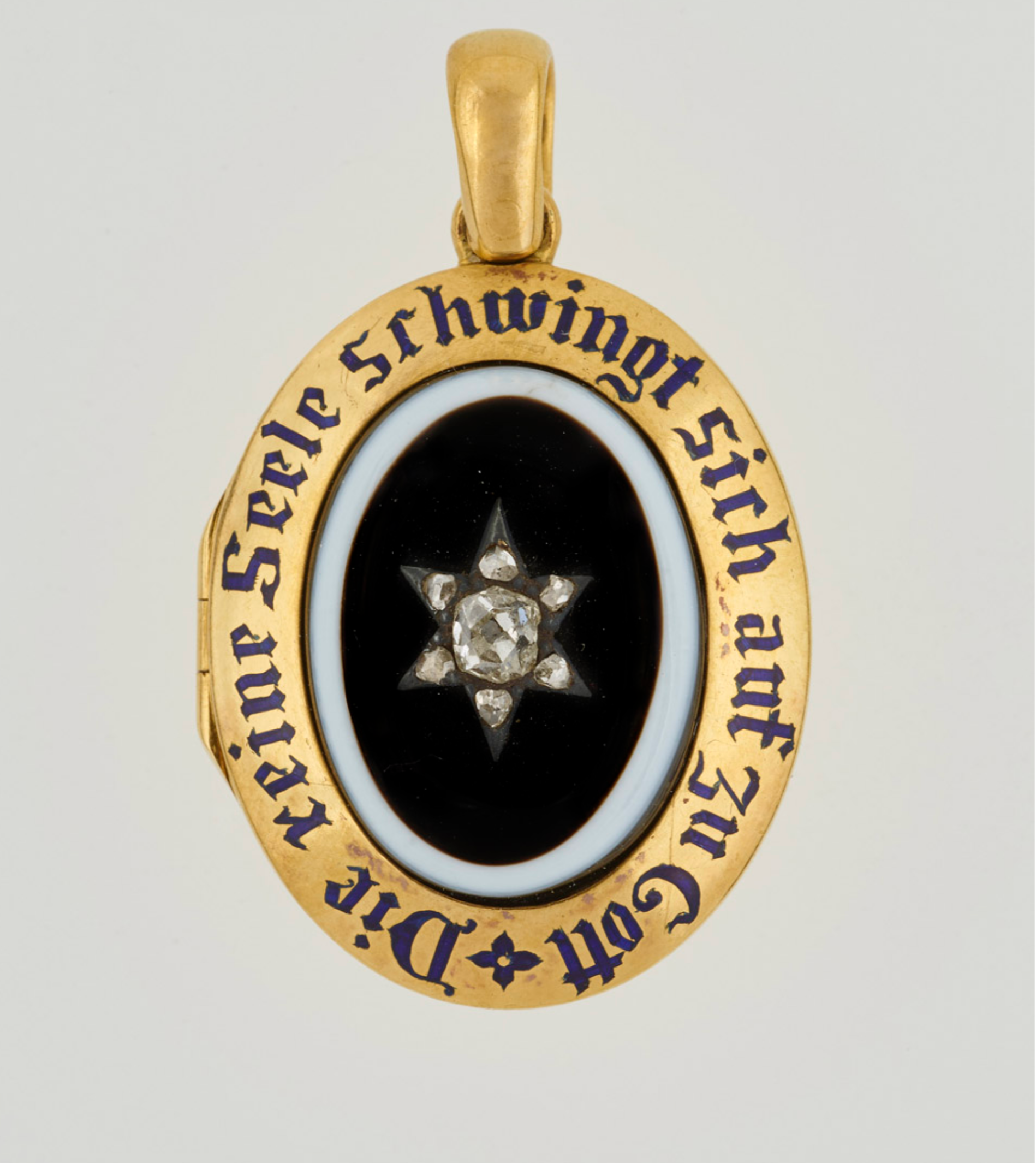 """A locket belonging to Queen Victoria, set with central oval onyx, black on white, with diamond star set in plain gold border with blue enamel inscription: """"The pure soul flies up above to the Lord"""""""