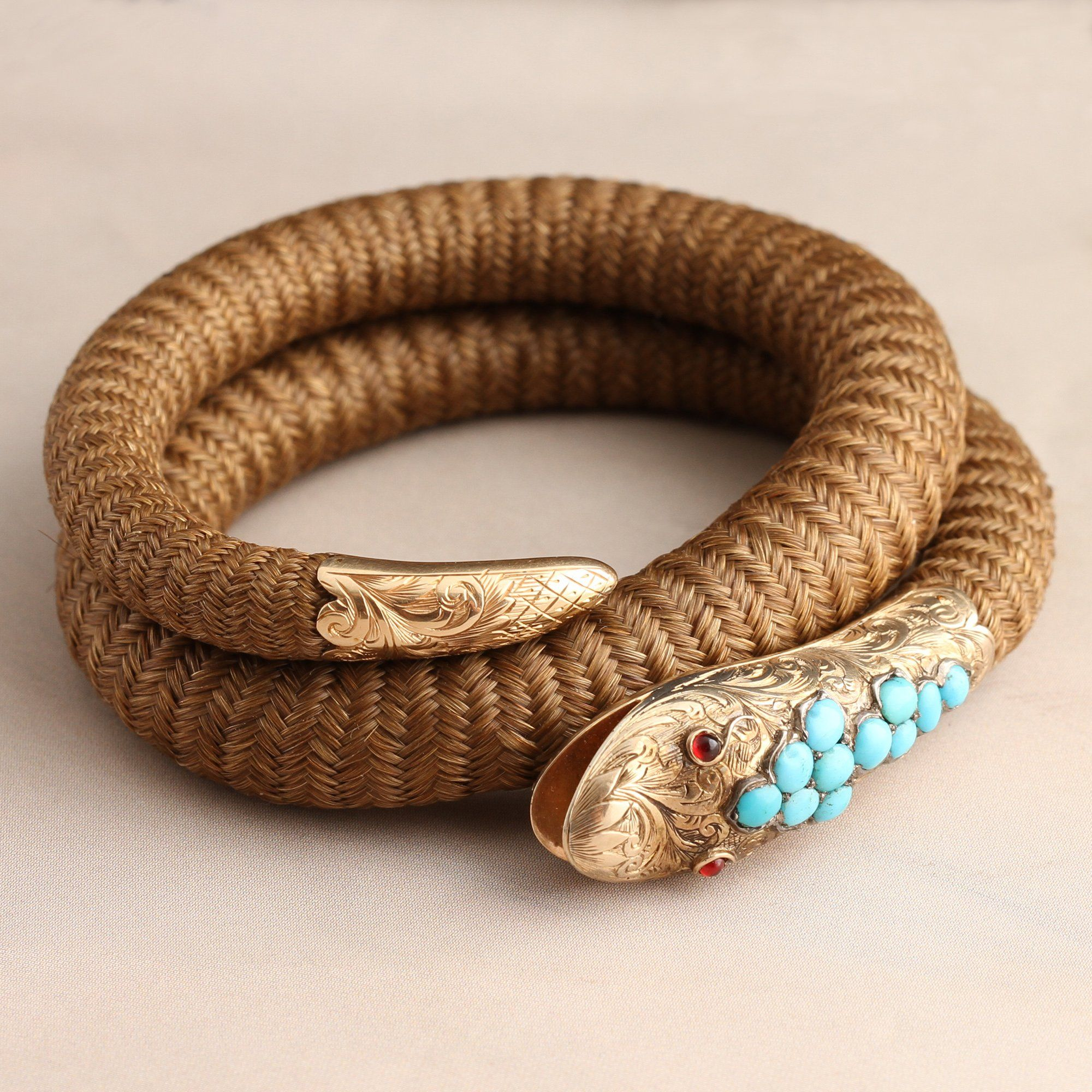 Detail of Victorian Coiled Serpent Hair Bangle with Garnets and Turquoise