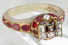 Photograph of Elizabeth I's ring, a white ring set with rubies on the shank and featuring a locket on the front.