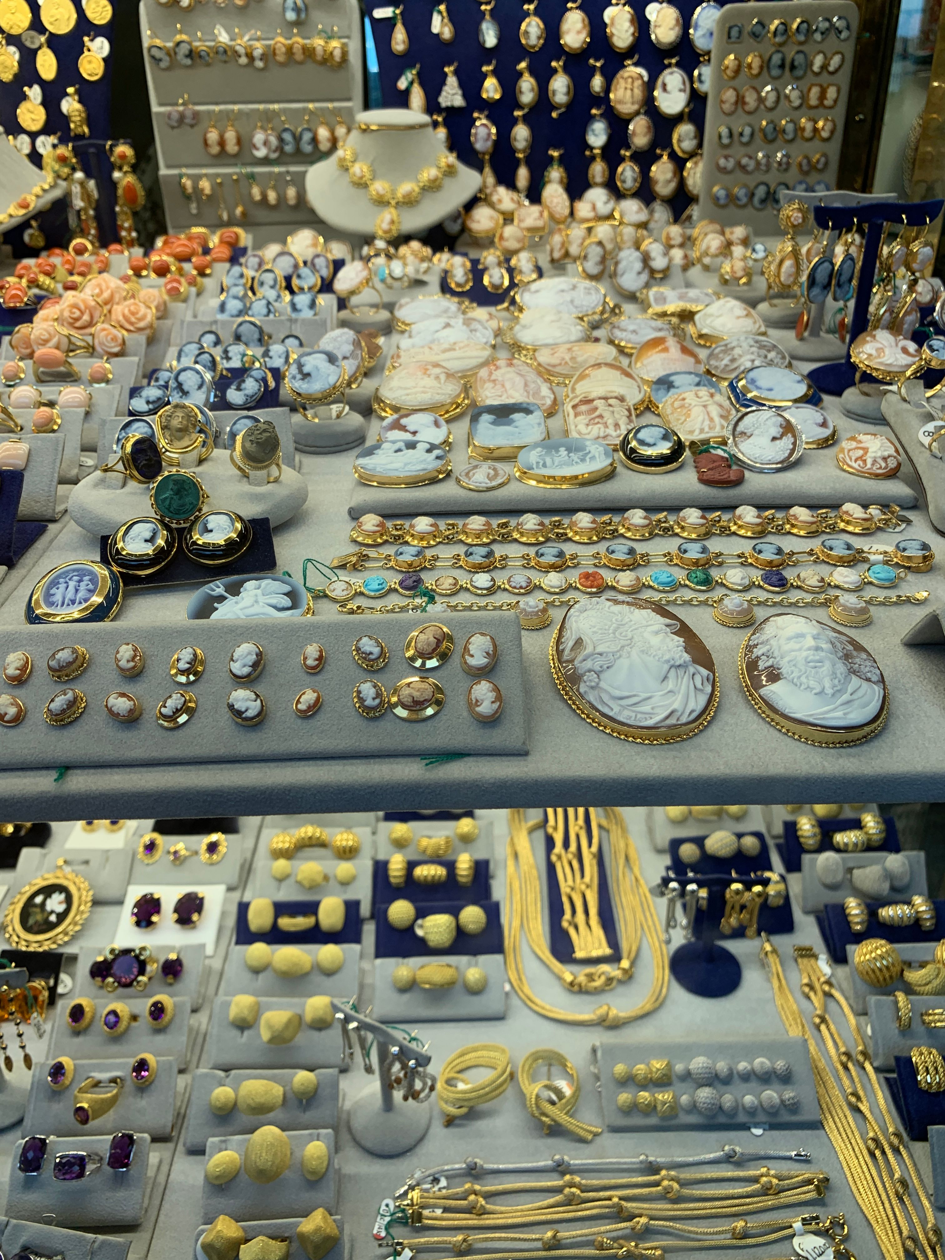A jeweler's shop window on the Ponte Vecchio, including coral jewelry.
