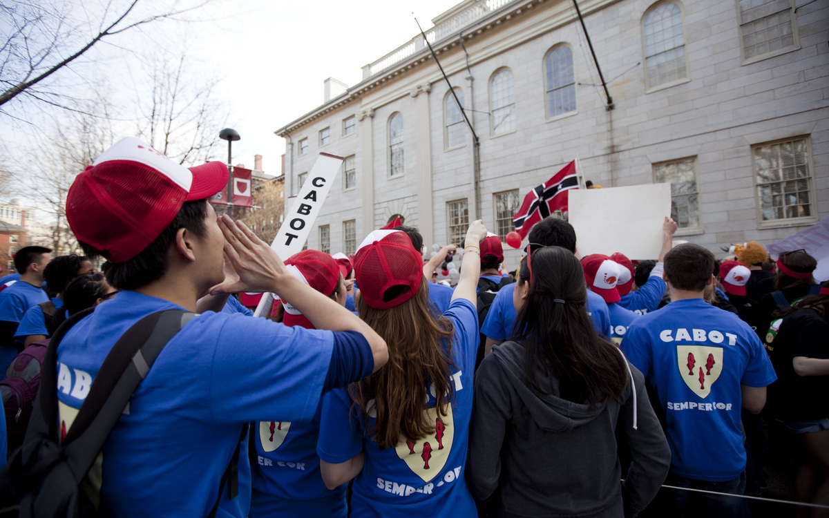 Cabot House residents gather outside University Hall on Housing Day. (Source)