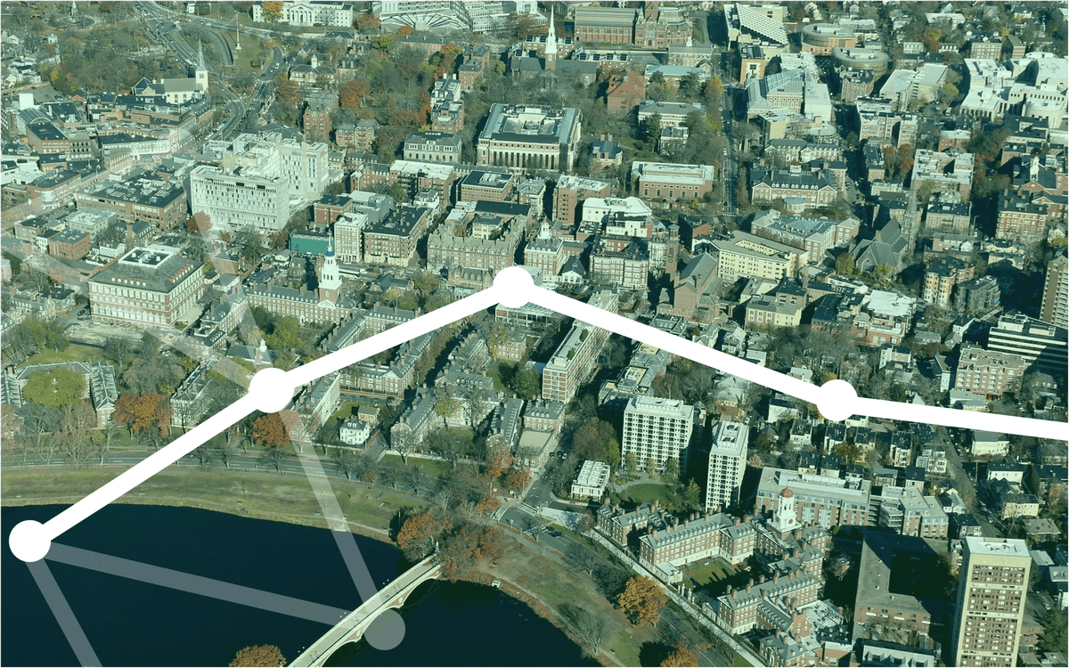 A green-tinted aeriel view of the upperclassman Houses at Harvard.