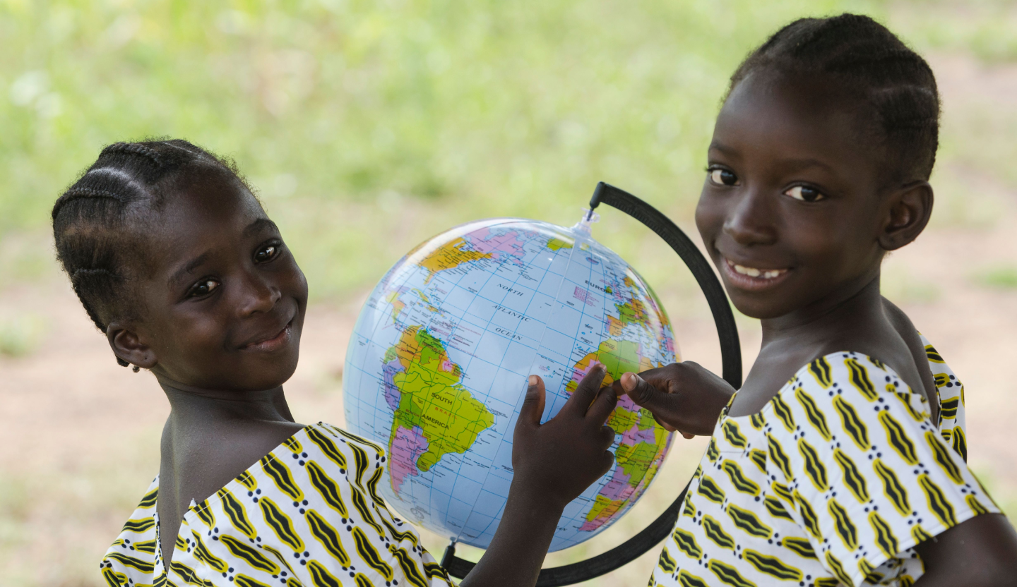 Two girls with the world map