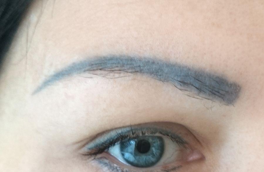 Old blue eyebrows tattoo