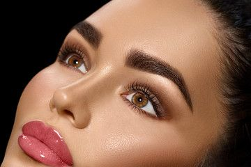 Brunette with bold fashion brows