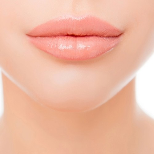 Close up photo of full woman's lips after augmentation