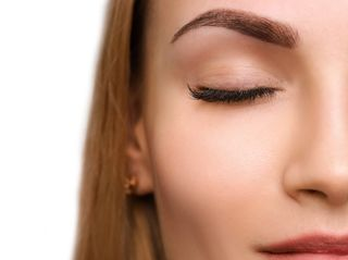 Woman with powder filled eyebrows without harsh front or outlines
