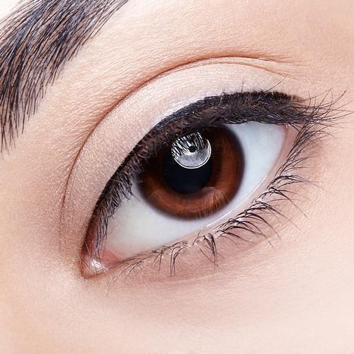 Woman eye permanent makeup lash line enhancement