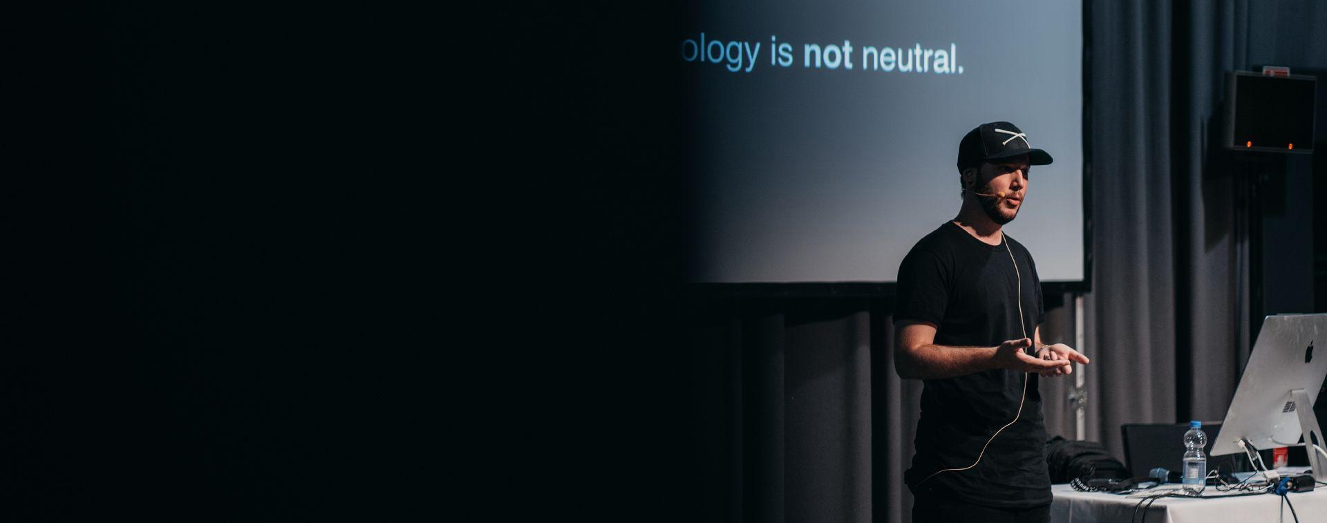 Daniel Zeitler speaking at a convention