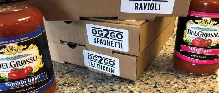 Boxes of pasta with labels and two jars of DelGrosso Sauce