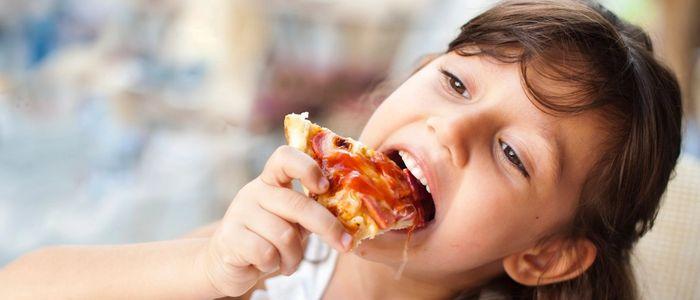 little girl eating dg2go pizza with dg2go pizza logo