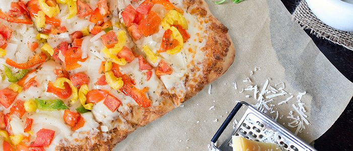 Square Pizza with tomatoes, peppers, onion, and cheese