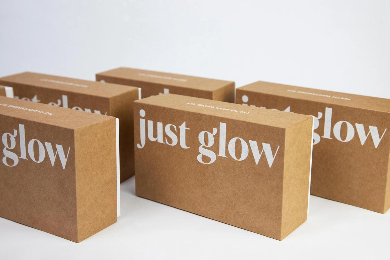a row of Just Glow Teeth Whitening Kits