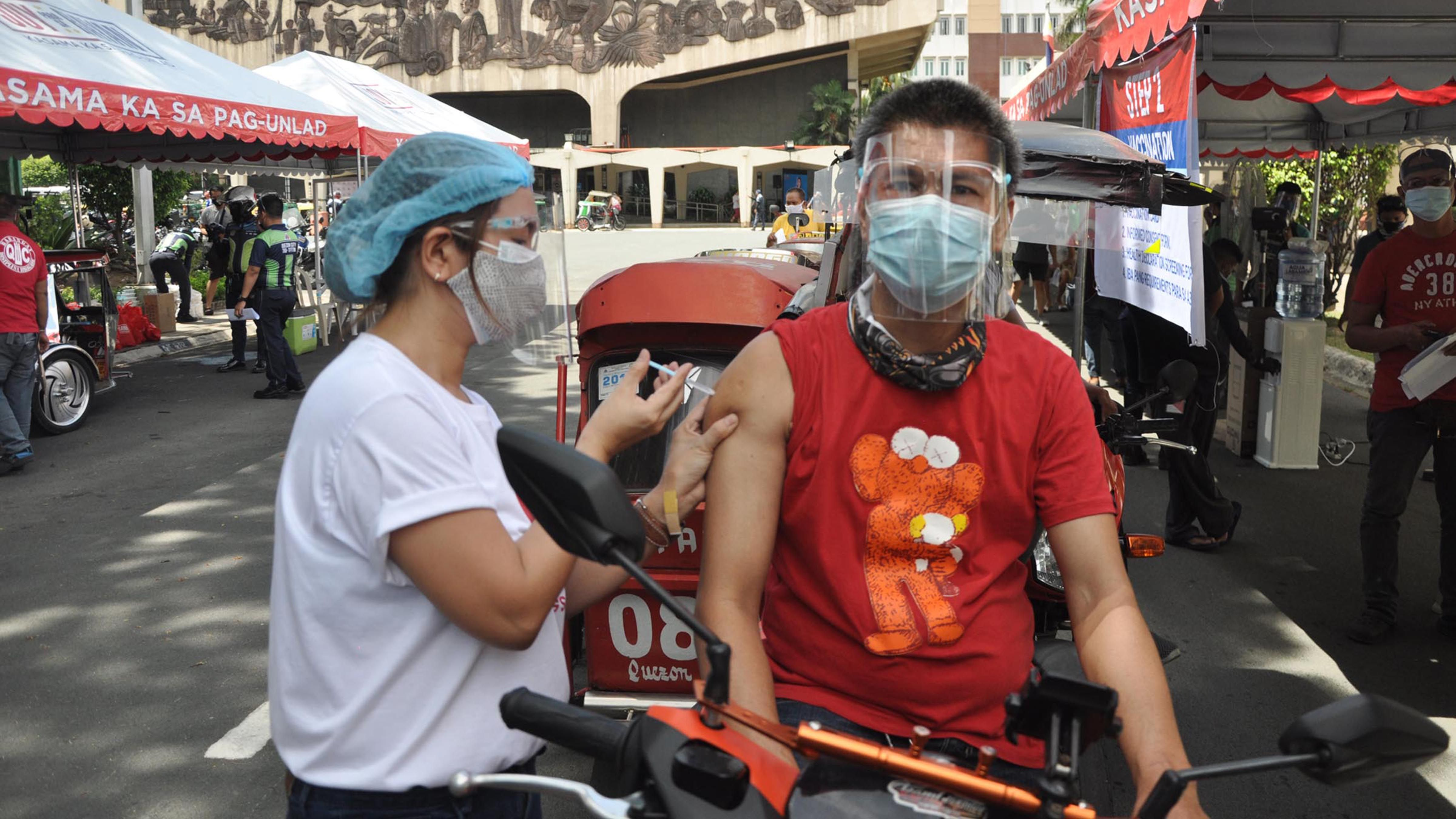 TRICYCLE DRIVERS GET THEIR VACCINES