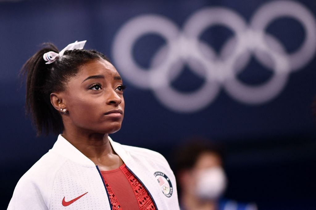 Tokyo Olympics America's top gymnast Simone Biles withdraws from women's group competitions photo from parade