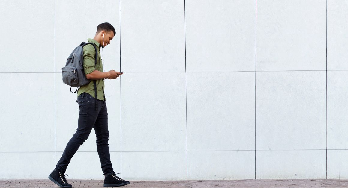 Student walking with phone