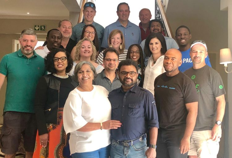 Group of award winners standing with Cisco's CEO and Head of HR in South Africa