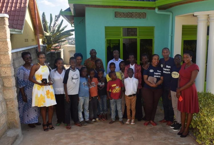 Alphonsine standing with staff and children after launching the Treasured Learning Center in Rwanda