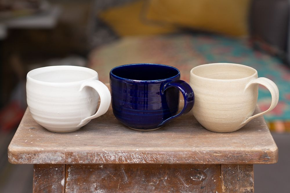 Three cups in different colours