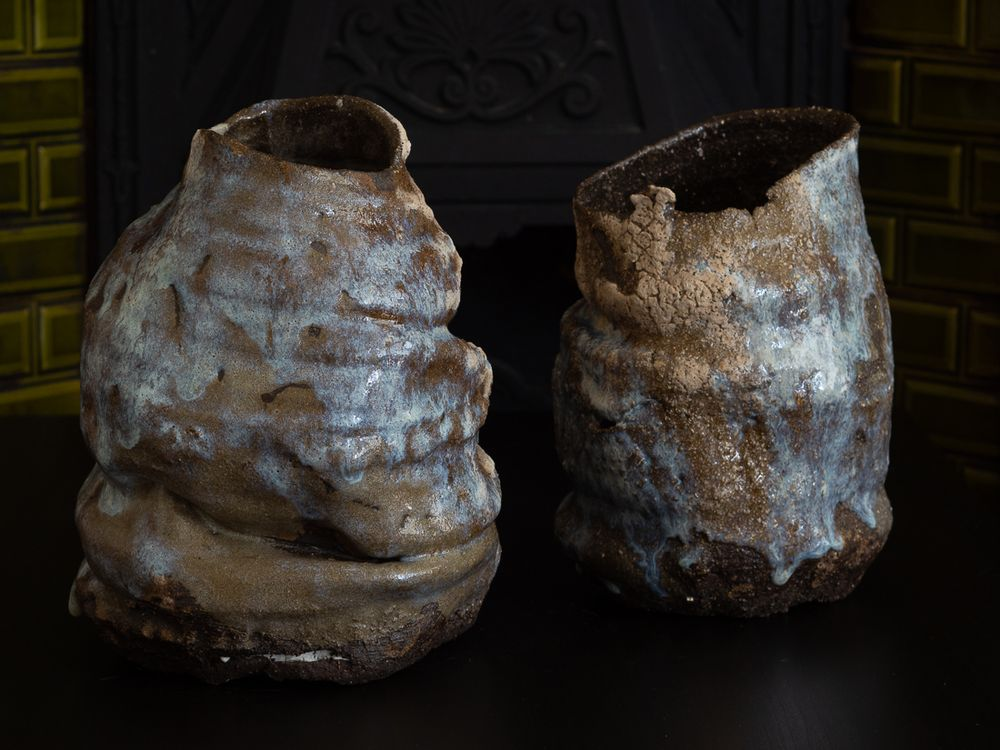 Two vessels with blue flashing on glaze