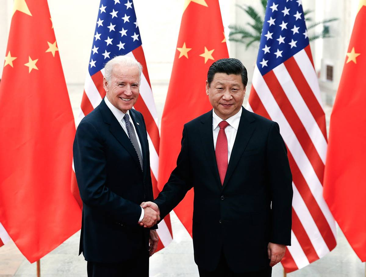 Chinese President Xi Jinping shakes hands with U.S Vice President Joe Biden inside the Great Hall of the People on Dec. 4, 2013, in Beijing
