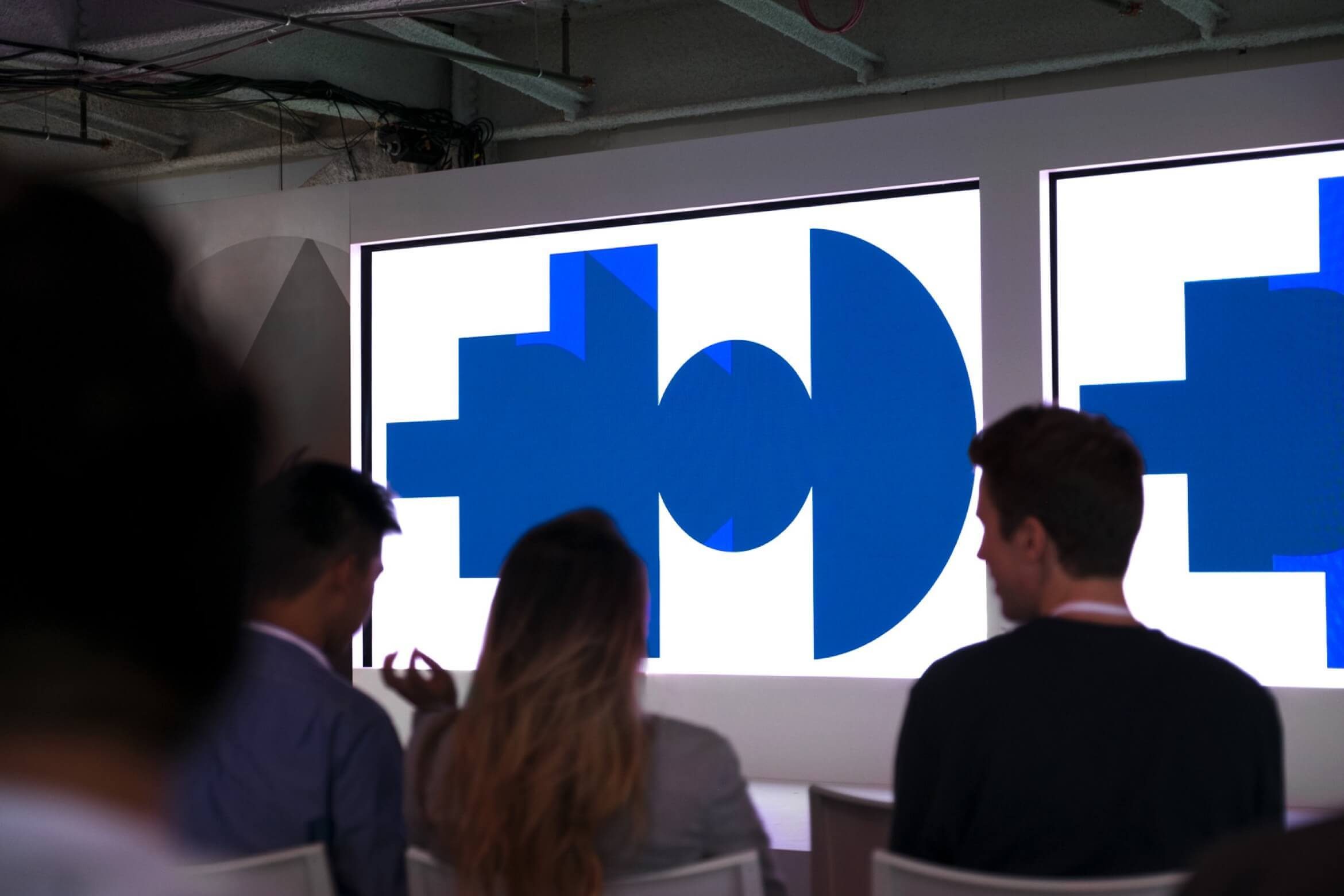 Photo of stage with Google Span shapes on displays
