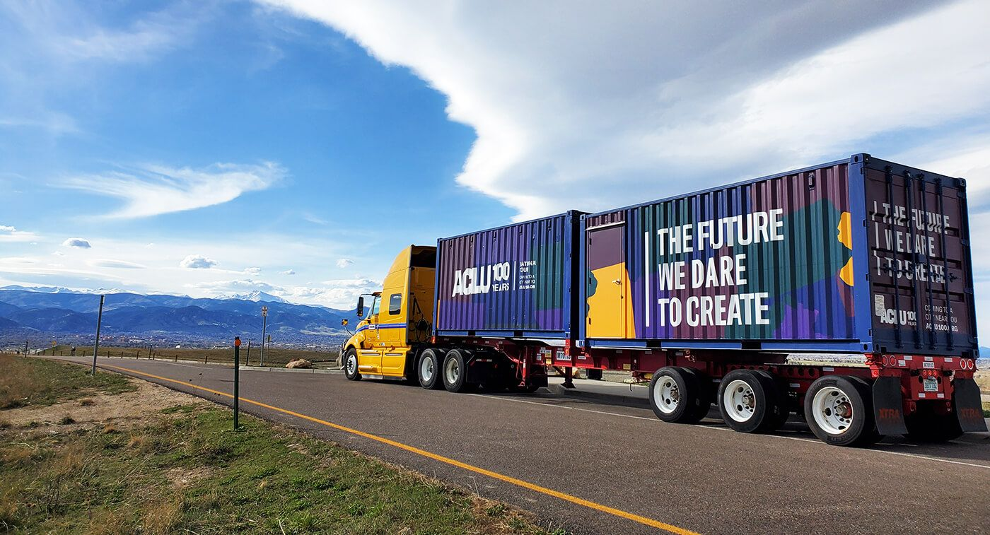ACLU 50 State Blueprint on tour showing a truck with message printed on