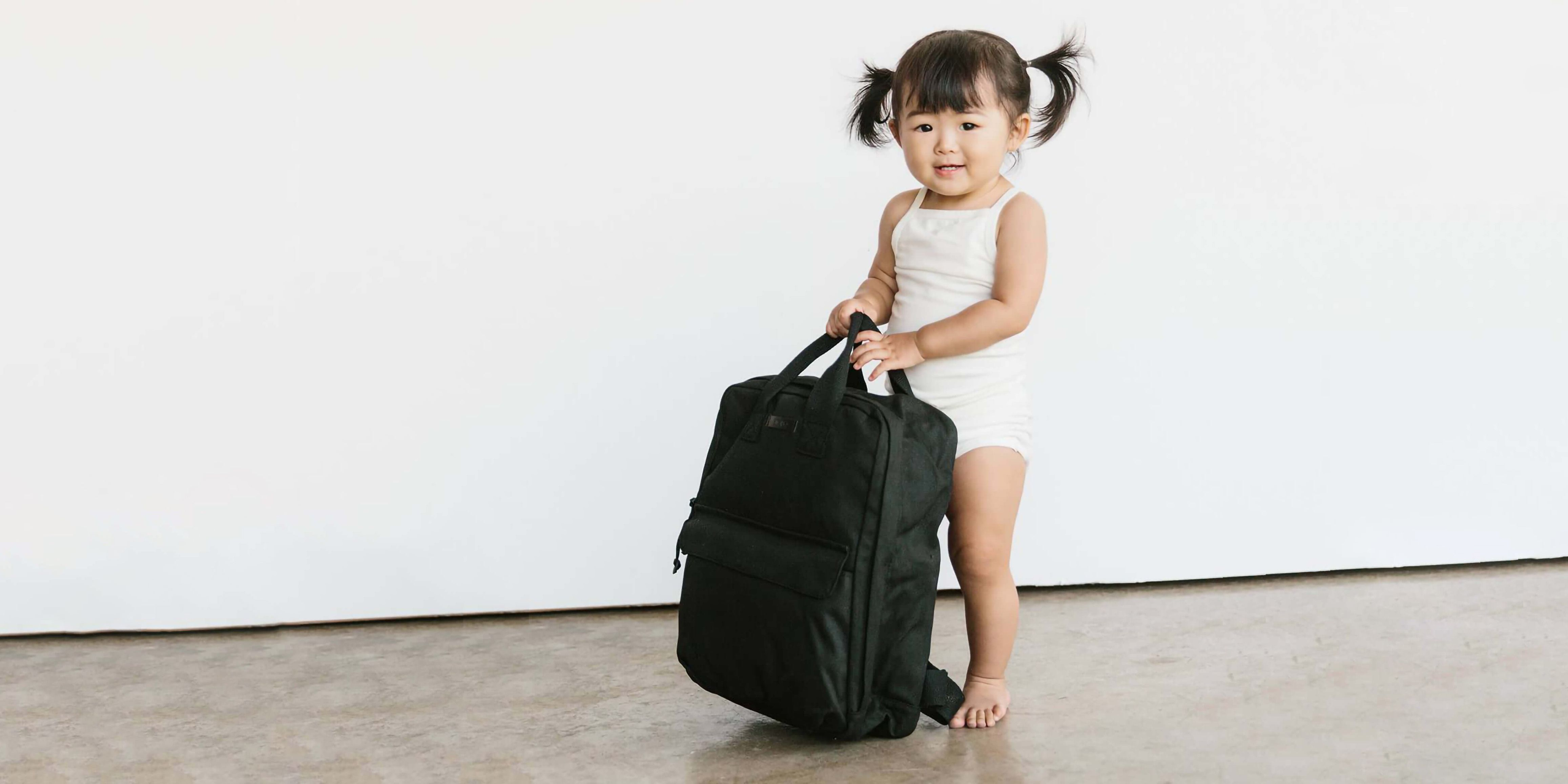 Photo of little girl carrying a Storq bag