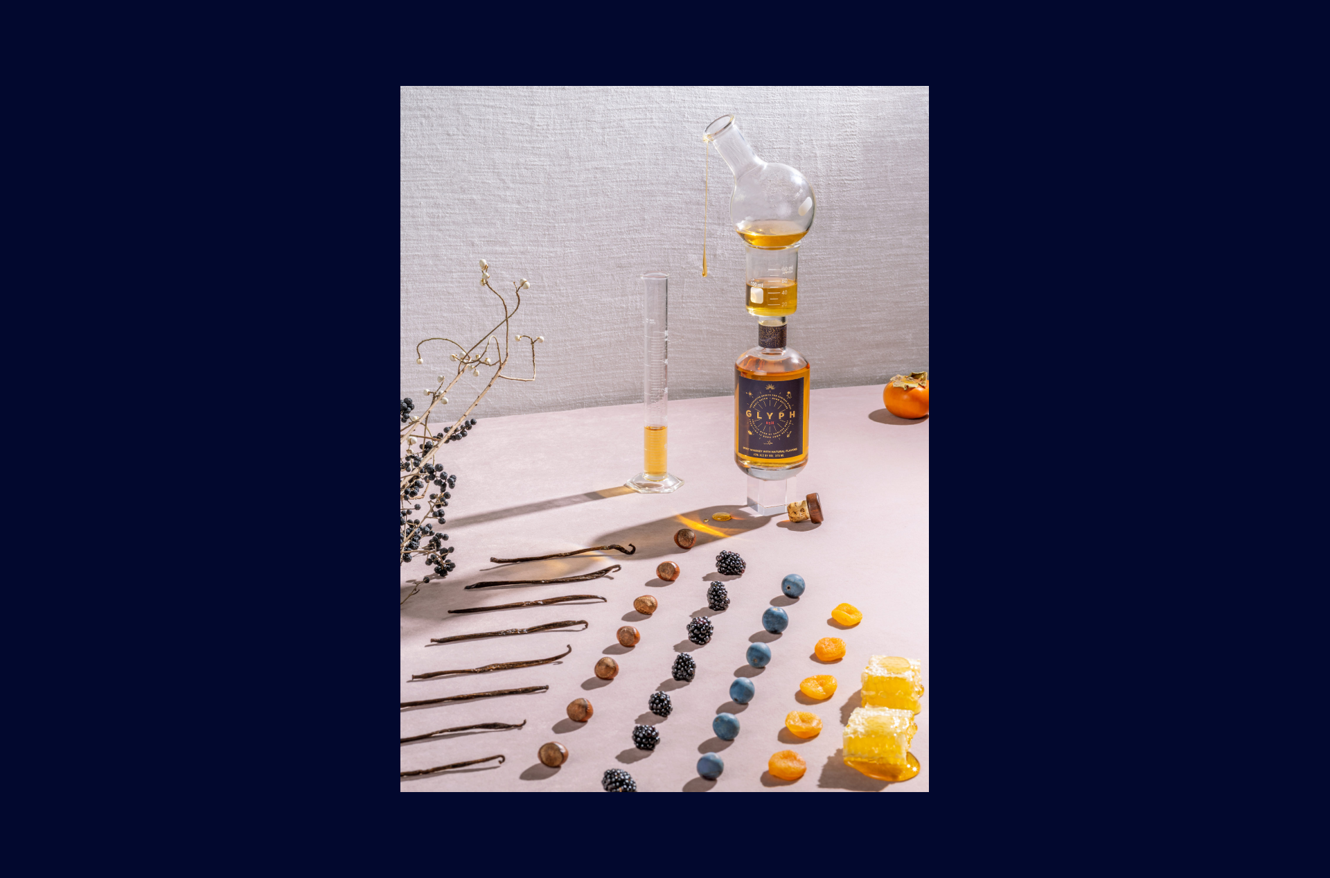 Still life photo of the Glyph bottle, fruits and test tubes