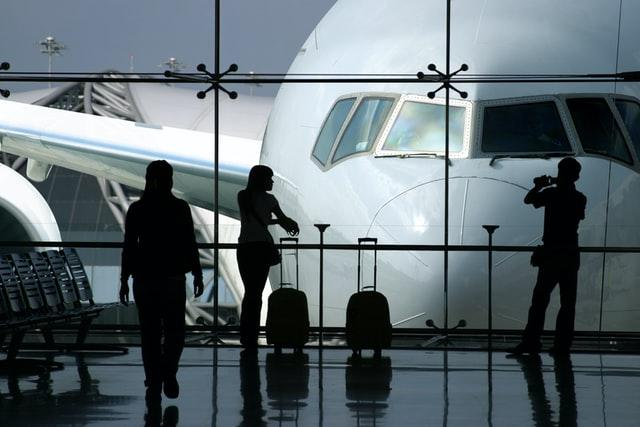 IAM users, roles, groups and roles explained in an airport