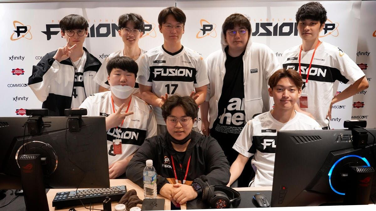 Philadelphia Fusion Overwatch team behind their monitors smiling