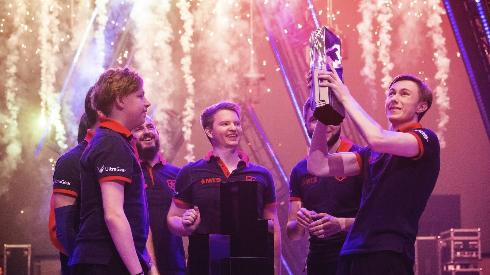 Gambit Esports Valorant team lift Masters Berlin trophy with fireworks behind them
