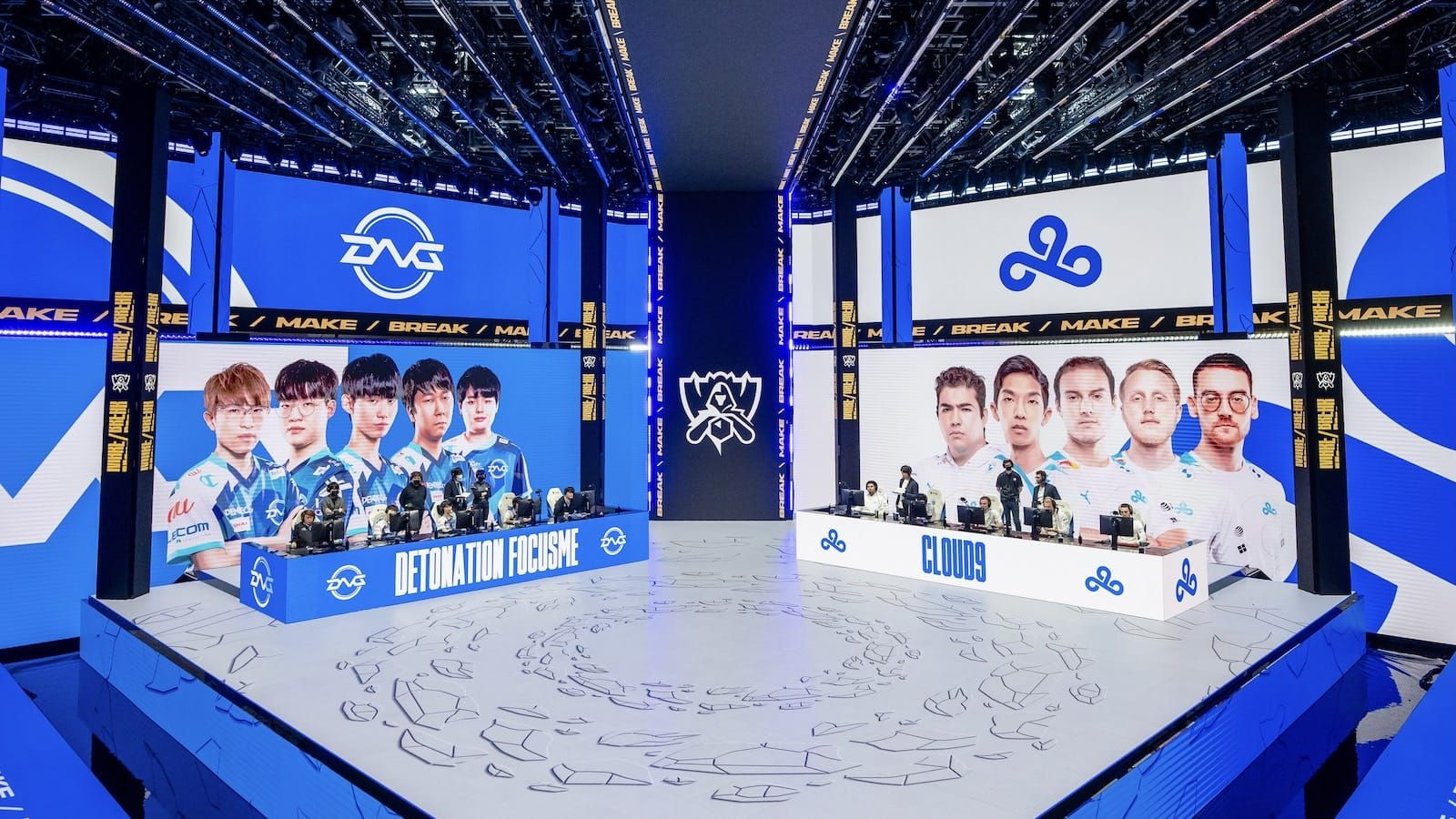 Cloud9 and Detonation Focus Me League of Legends teams on stage at their PCs at Worlds 2021