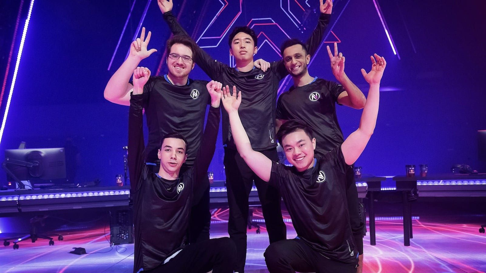 Envy Valorant team pose with arms raised on stage after win at Masters Berlin