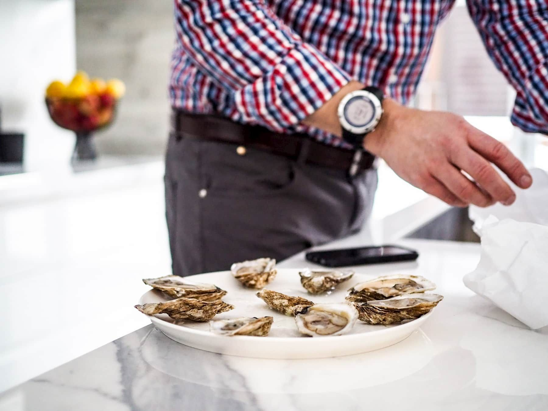 man with oysters