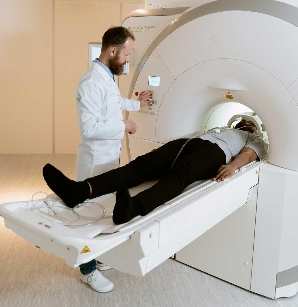 man having an mri to detect cancer