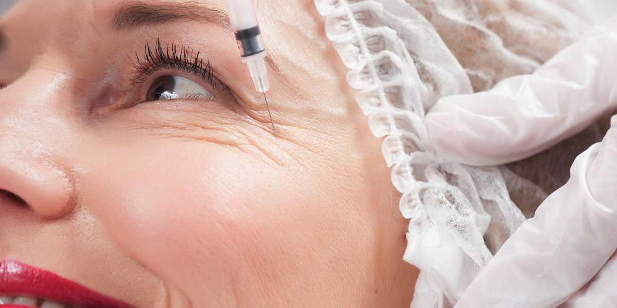woman getting botox near eyes